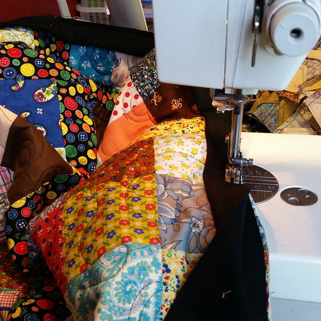 I'm squeezing in some time to bind a charity quilt. #joscountryjunction  #charityquilts  # patchwork #quilting